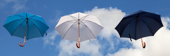 Hanging Umbrellas in Blue, White and Dark Blue