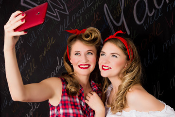 Two pin-up girlfriends do selfie