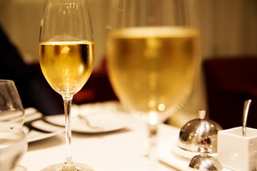 glasses of champagne in golden colors