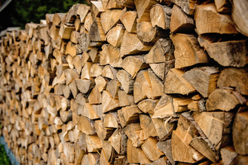 pile of wood ready for winter fireplace heating