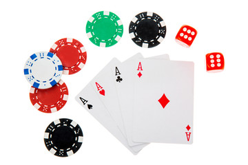 Four aces with different poker chips and dice isolated on white