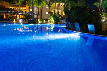 Swimming pool at a luxury Caribbean, tropical resort at night