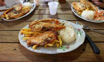 Typical Colombian meal - Chicken, Rice, Fries, Salad