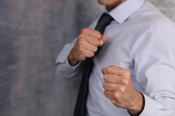 Fighting for your ideas, protect ideals. Leadership ,competition, success concept. Businessman in boxing fighting stance