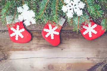 Christmas decorations on oldboards. Christmas Socks. Christmas background. New Year background. Xmax background. Christmas tree. Snow falls.