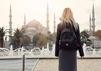 Visit Turkey concept. Woman traveler in front of Blue Mosque in Istanbul