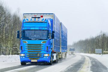 Van in road in winter Rovaniemi