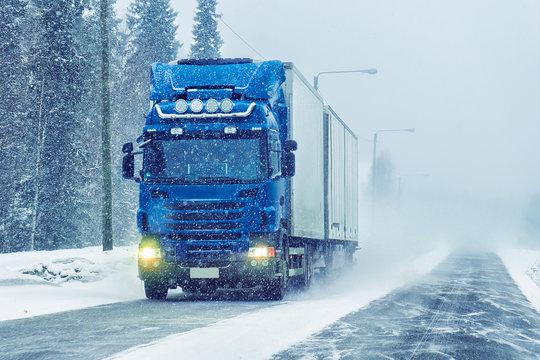 Van in road of winter Rovaniemi