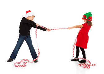 Christmas: Boy And Girl Playing Tug Of War With Christmas Ribbon