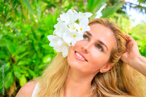 Sweet Blonde Girl With Frangipani