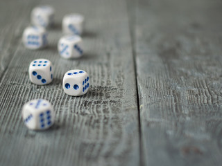 Dice blue and white color on wooden rustic table.