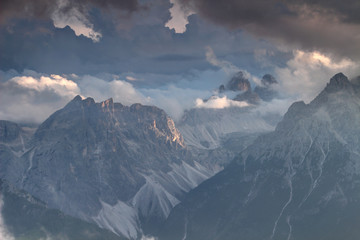 Sexten Dolomites in sunlit clouds at sunset with Drei Zinnen Tre Cime di Lavaredo, Einserkofel Cima Una and Paternkofel Monte Paterno peaks, Fischleintal Val Fiscalina valley South Tyrol Italy Europe