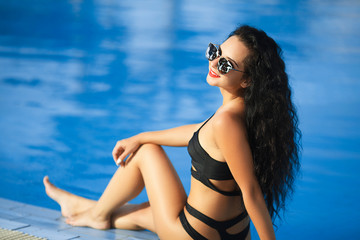 Beauty and body care. Sensual young woman relaxing in outdoor spa swimming pool