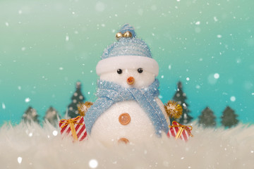Happy snowman standing in gold winter christmas snow background. Merry christmas and happy new year greeting card with copy space. Christmas celebration holiday background.