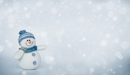 Cute snowman on cold grey background with snow fall, design for happy holiday celebration