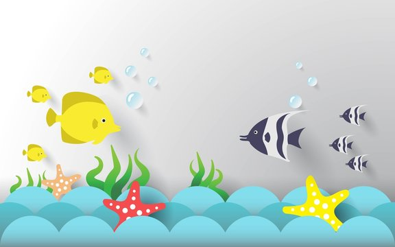 Paper art style.Fish and starfish on the ocean waves.