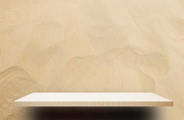 Empty cream cement shelf on sandy background