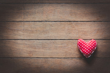 Heart shape toy on wooden background