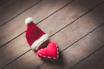 Heart shape toy and Santa Claus hat