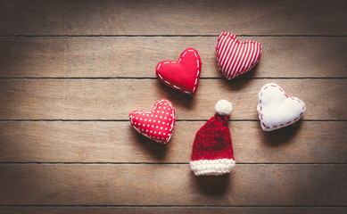 Santa Claus hat and heart shape toys