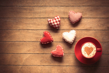 Cup of coffee and heart shape toys