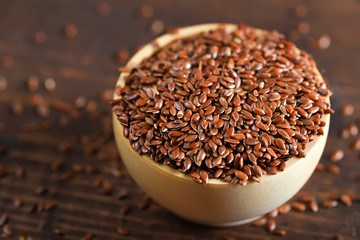 Linseed in wooden bowl organic food concept
