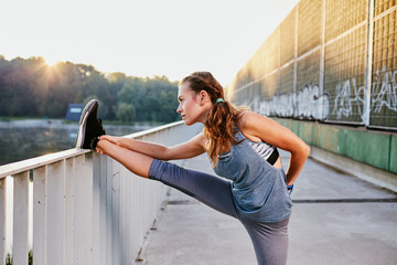 Female runner stretching during morning workout
