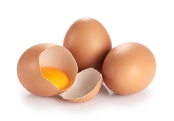 Eggs isolated on white background. Broken egg, yolk.