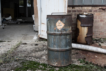 Poison symbol and text on rusty barrel
