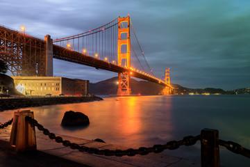 Golden Gate Bridge and Chain Link Fence at Night. Fort Point, San Francisco, California, USA.