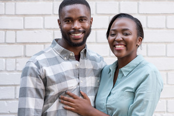 Smiling African couple standing together in the city