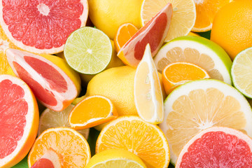 fruits with vitamin C are finely chopped and lie as a background, apilxine and lemons