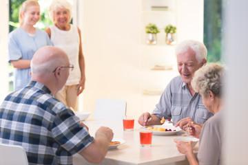 Senior people eating dinner