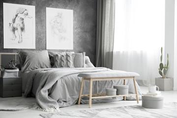 Drawings in bright grey bedroom