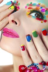 Wall Mural - Разноцветный яркий макияж и маникюр.