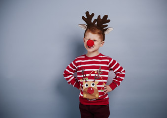 Portrait of boy in christmas costume .