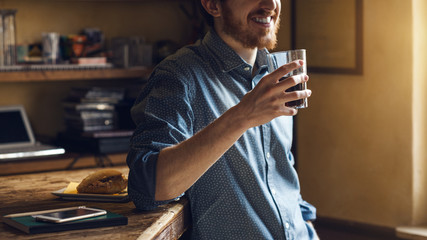 Hipster man drinking a glass of coke