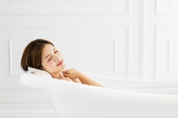 young Beautiful woman relaxing in bathtub