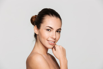 Beauty portrait of a smiling young half naked woman