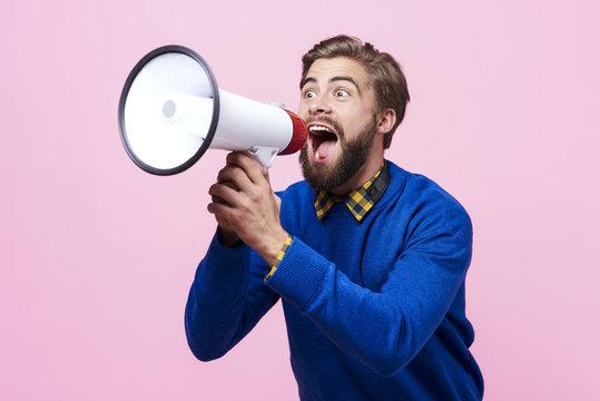Man yelling into a megaphone ..