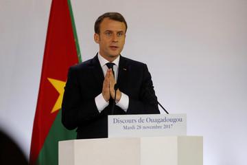 French President Emmanuel Macron delivers a speech at the Ouagadougou University