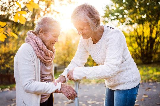 Senior women on a walk in autumn nature.