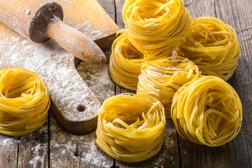 Homemade pasta on a wooden background