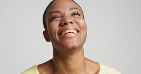pretty mixed race woman with short hair laughing