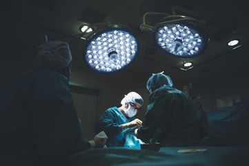 Group of surgeons working with patient