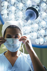 Woman wearing mask in surgery room
