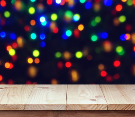 Empty wooden deck on blurred background with bokeh.