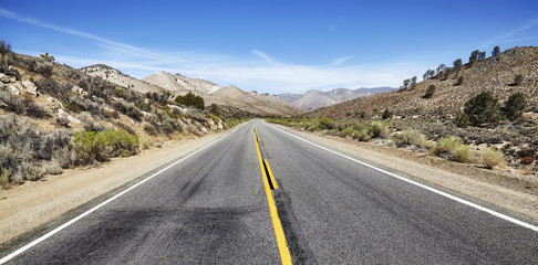 Deserted highway in the Death Valley, USA.