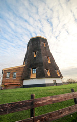 Former windmill reconstructed to house along the river Rotte in Moerkapelle , Netherlands