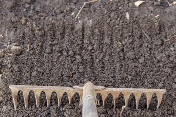 rake on plowed land